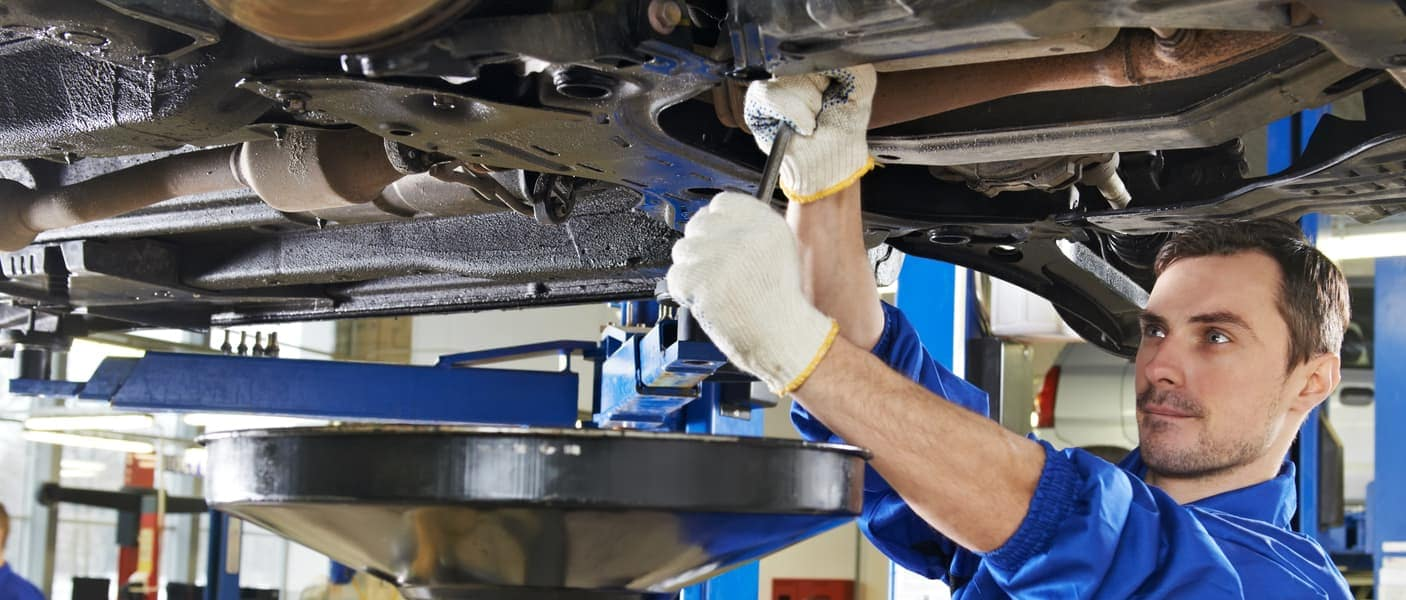 Technician servicing vehicle