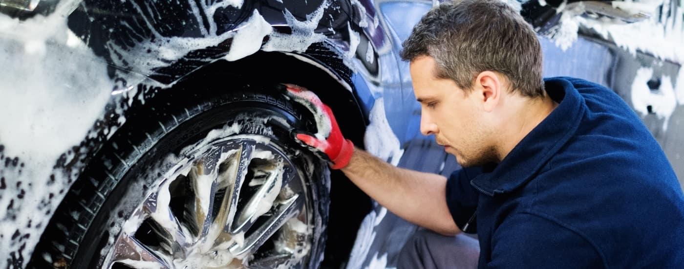 man washing tires