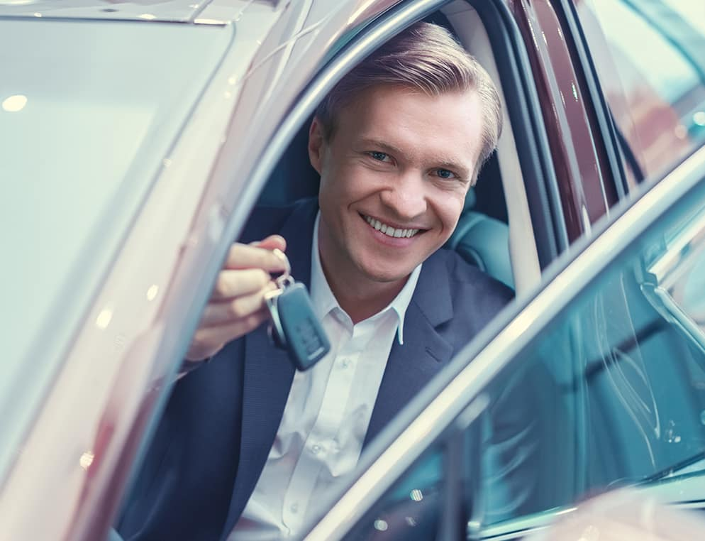 when to trade in your vehicle at Boch Automotive in Massachusetts | Man holding keys