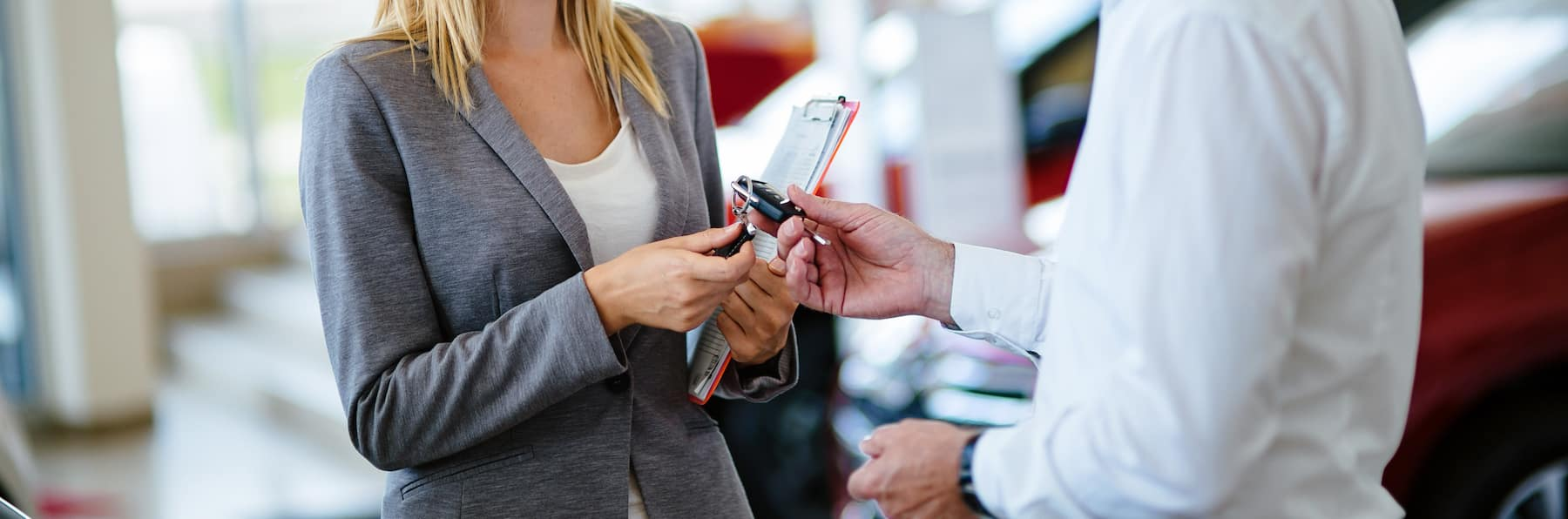 Best Time to Trade in a Vehicle at Boch Auto Group | Man handing car key to sales agent