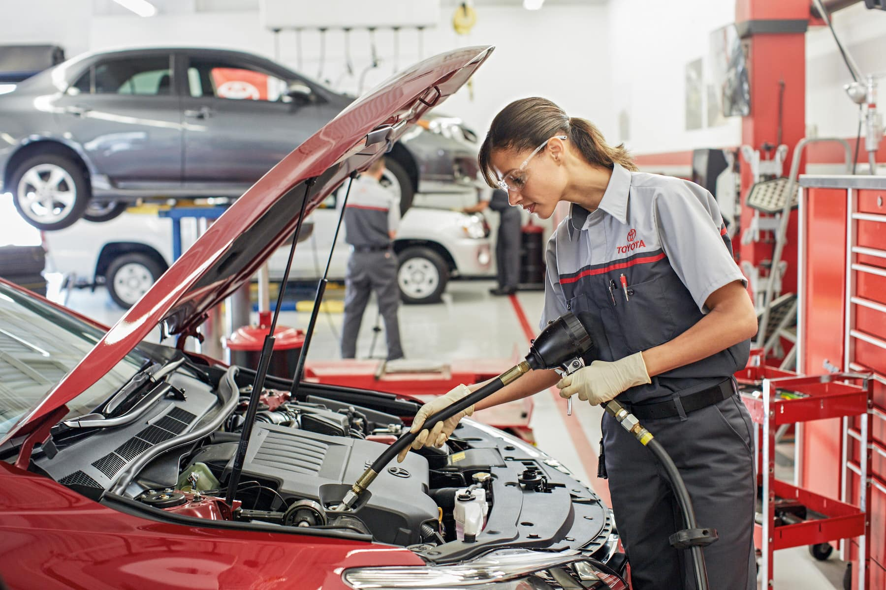 Who makes the best synthetic oil for cars and trucks at Boch New & Used Cars in Massachusetts | toyota technician filling car engine