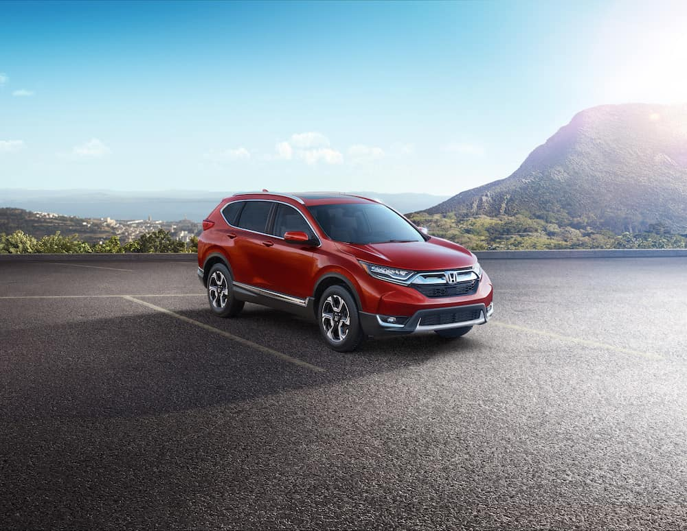 How to change a tire step-by-step guide at Boch Honda in Norwood | Red honda CR-V parked on parking lot