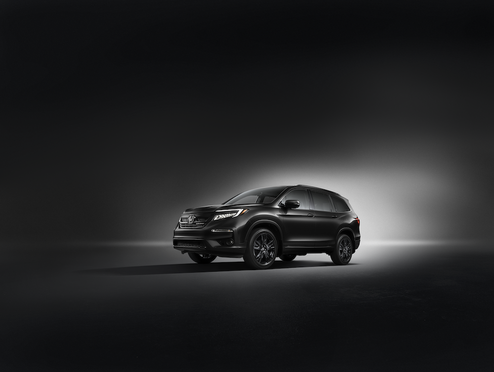 Model Features of the 2020 Honda Pilot at Boch Honda in Norwood | Black 2020 Pilot parked with a black background