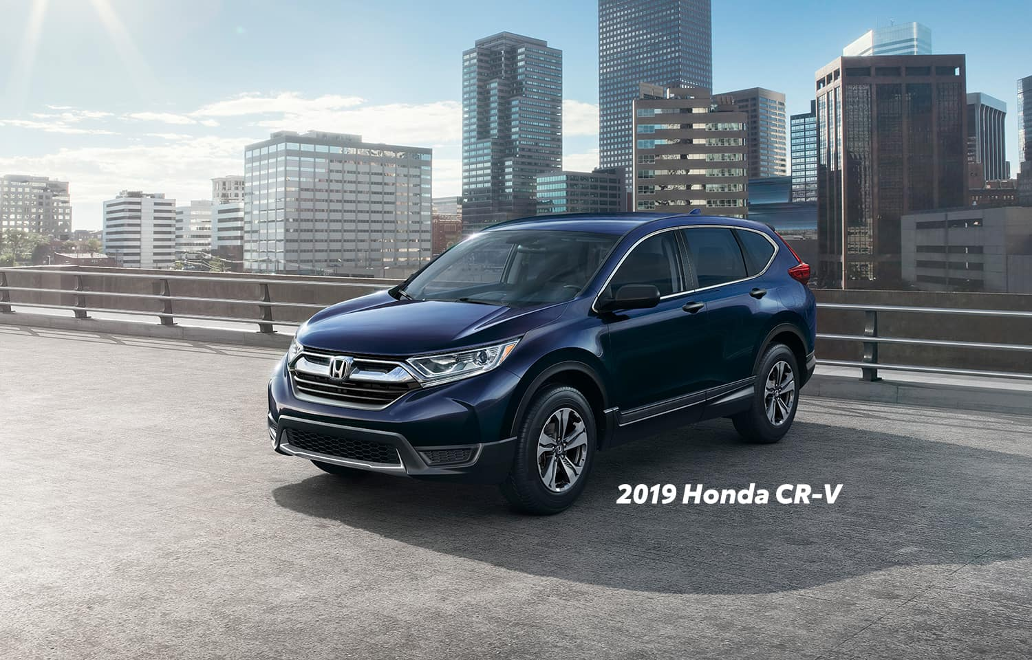 Comparison of the 2019 Pilot versus 2019 CR-V at Boch Honda of Norwood | Midnight blue 2019 Honda CR-V parked in a parking lot