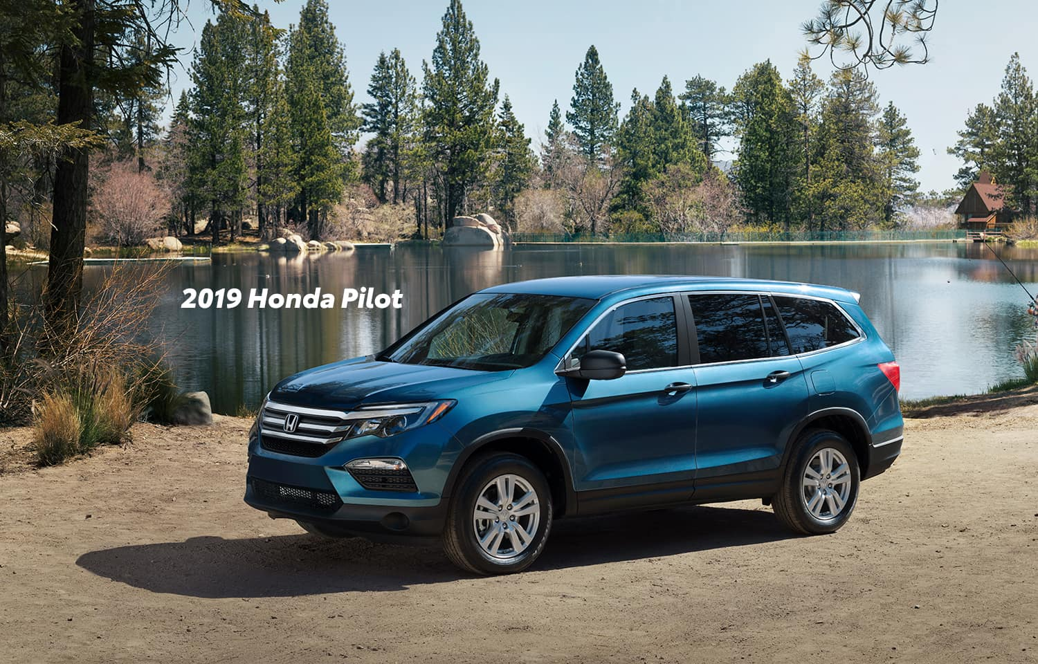 Comparison of the 2019 Pilot versus 2019 CR-V at Boch Honda of Norwood | Blue 2019 Honda Pilot Parked in the wood
