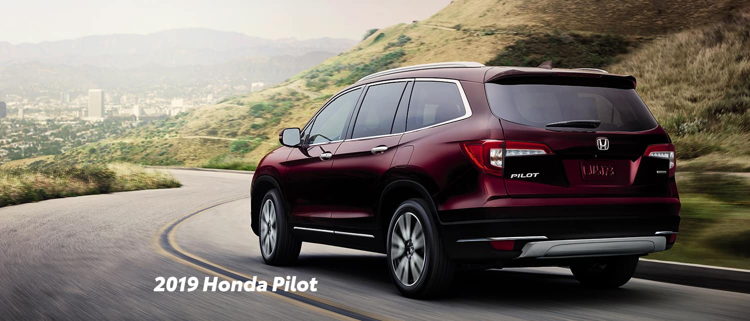Comparison of the 2019 Pilot versus 2019 CR-V at Boch Honda of Norwood | Red 2019 Honda Pilot running on road