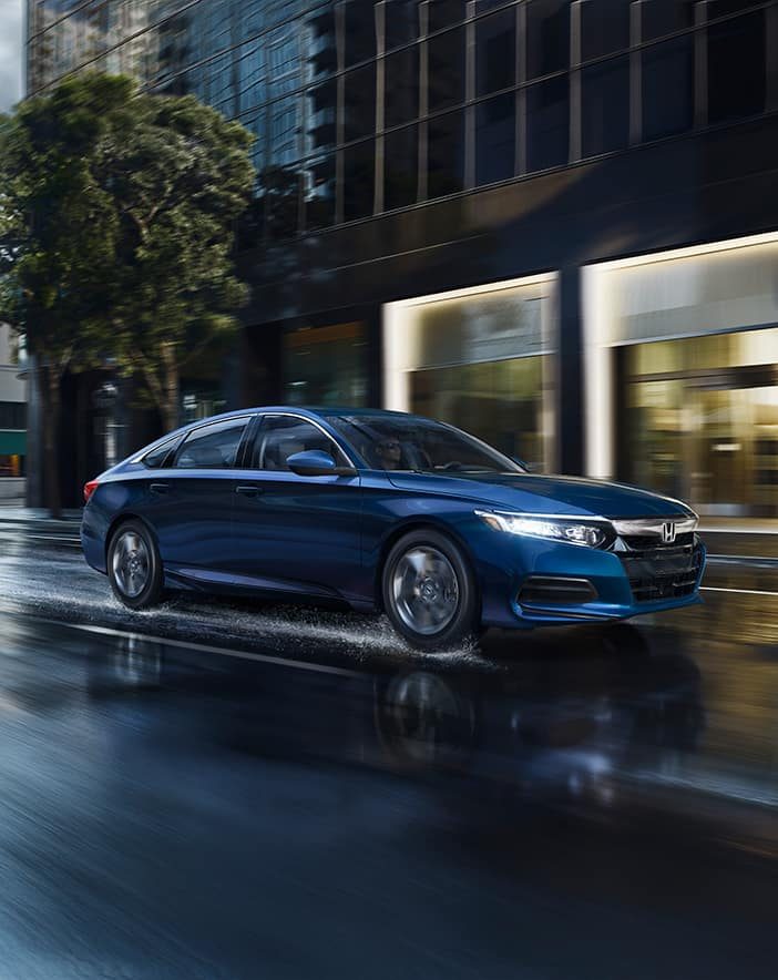 comparison-of-the-2020-Civic-and-the-2020-Accord-Massachusetts | Blue 2020 accord running on the road