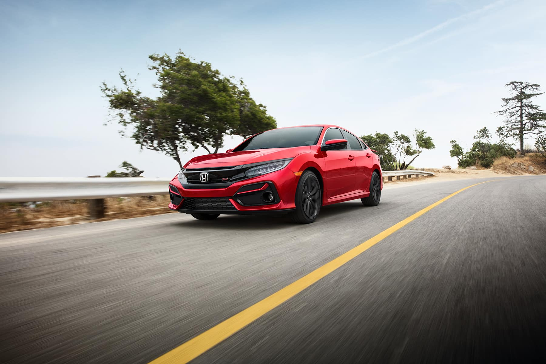What you can get to personalize your vehicle at Boch Honda in Norwood | red honda civic driving on road