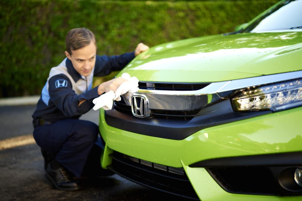 What you can get to personalize your vehicle at Boch Honda in Norwood | Honda technicians cleaning a honda