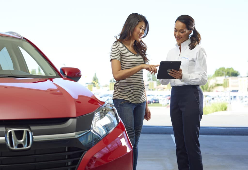 What you can get to personalize your vehicle at Boch Honda in Norwood | Honda agent showing woman car information