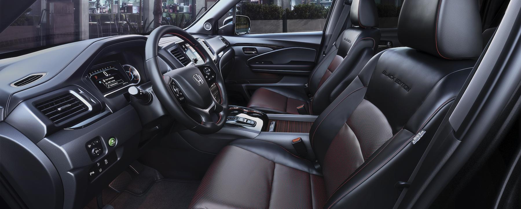 Compare the 2020 Honda Pilot and 2020 Subaru Ascent at Boch Honda of Norwood MA | The interior of the black honda pilot