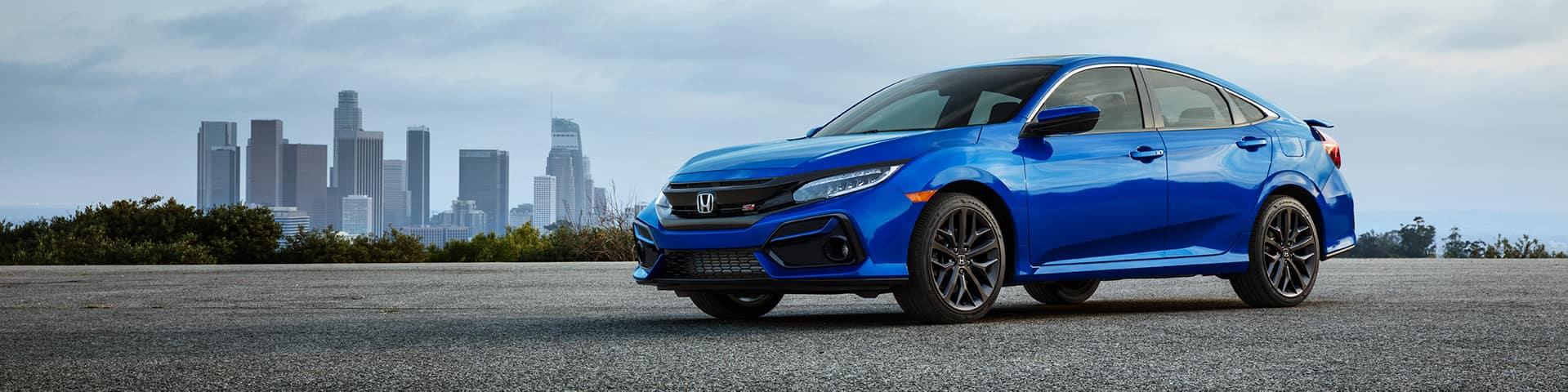 Boch Honda is a Car Dealership near Westwood MA | Blue MY20 Honda Civic Sedan parked outside city