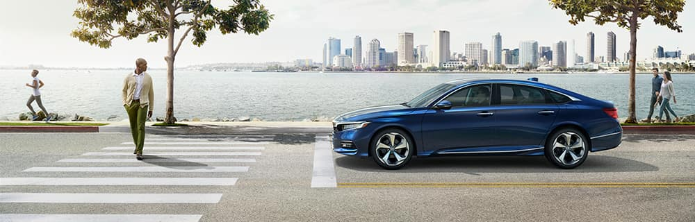 Model features of the 2019 Honda Accord | Blue Honda Accord on Road