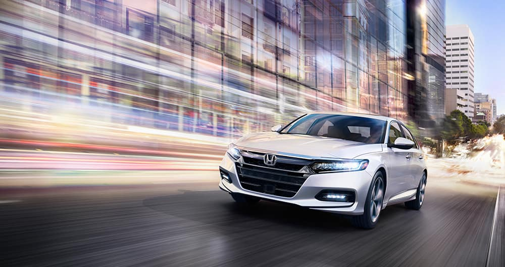 Model features of the 2019 Honda Accord | Sliver Honda Accord on Road