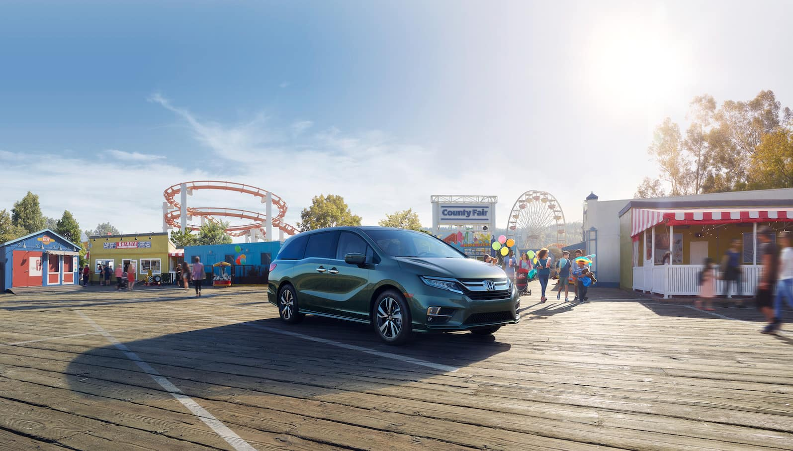 Model Features of the 2019 Honda Odyssey at Boch Honda West of Westford | 2019 odyssey parked at an amusement park