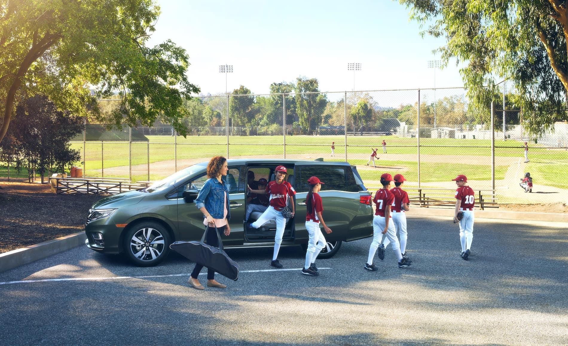 What will protect your Honda's interior at Boch Honda West of Westford | Honda parked at a kid baseball game