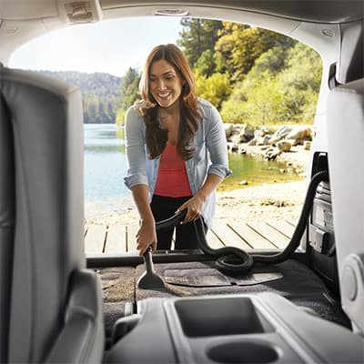 Model Features of the 2019 Honda Odyssey at Boch Honda West of Westford | woman cleaning the trunk of the odyssey