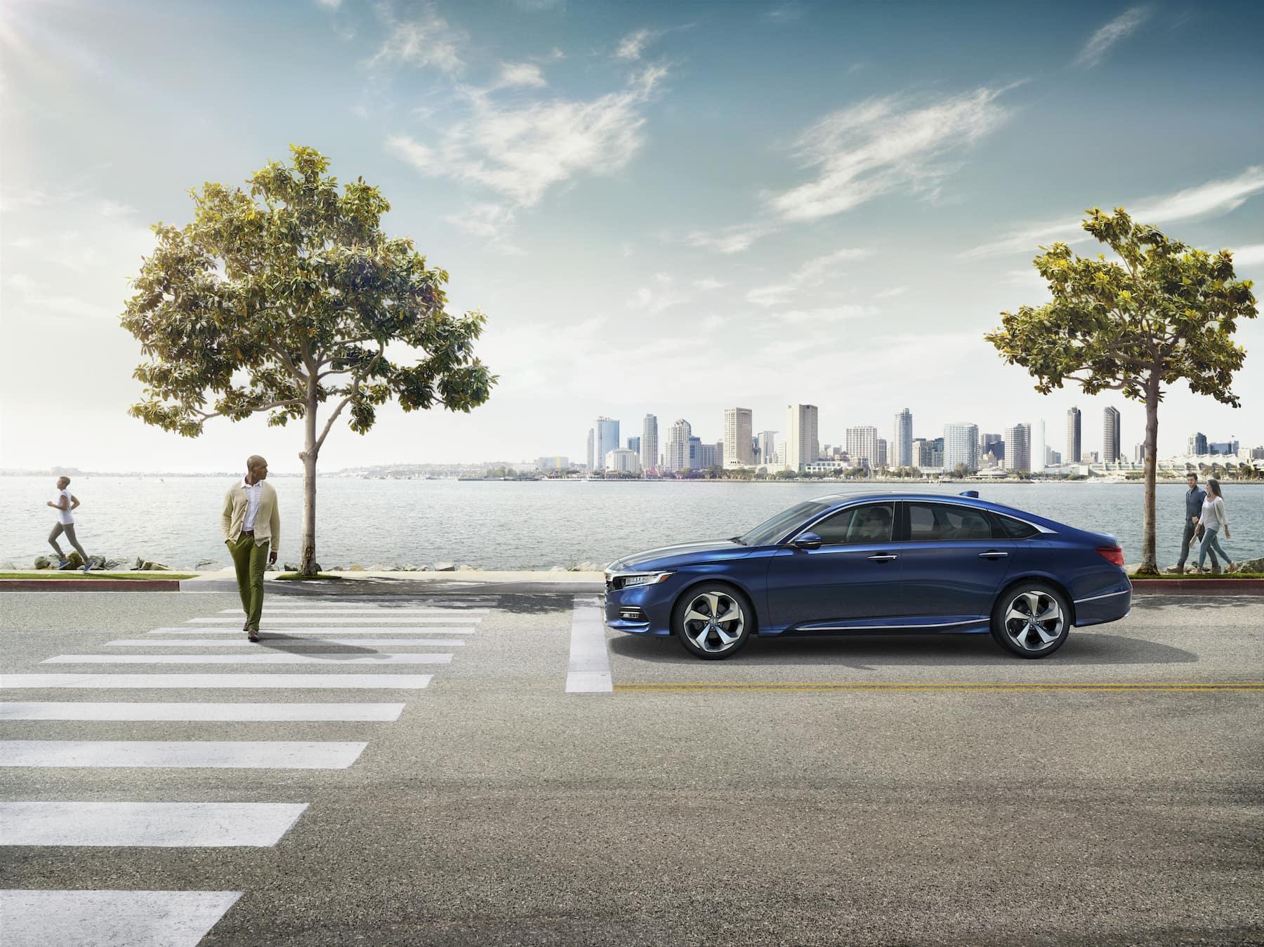 Comparison of the 2020 Civic Sedan vs. the 2020 Accord at Boch Honda West of Westford MA | blue 2020 honda accord on the street