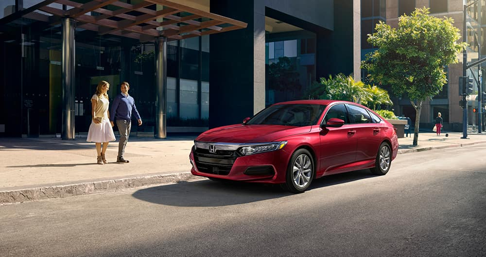 Comparison of the 2020 Civic Sedan vs. the 2020 Accord at Boch Honda West of Westford MA | red 2020 honda accord parked outside a building