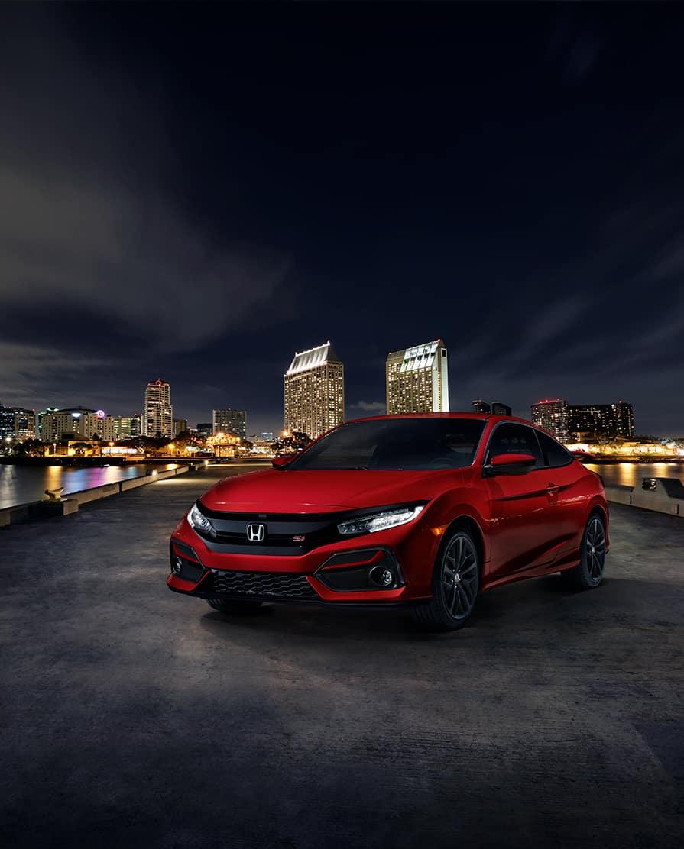 Comparison of the 2020 Civic Sedan vs. the 2020 Accord at Boch Honda West of Westford MA | red 2020 honda civic park at a garage at night