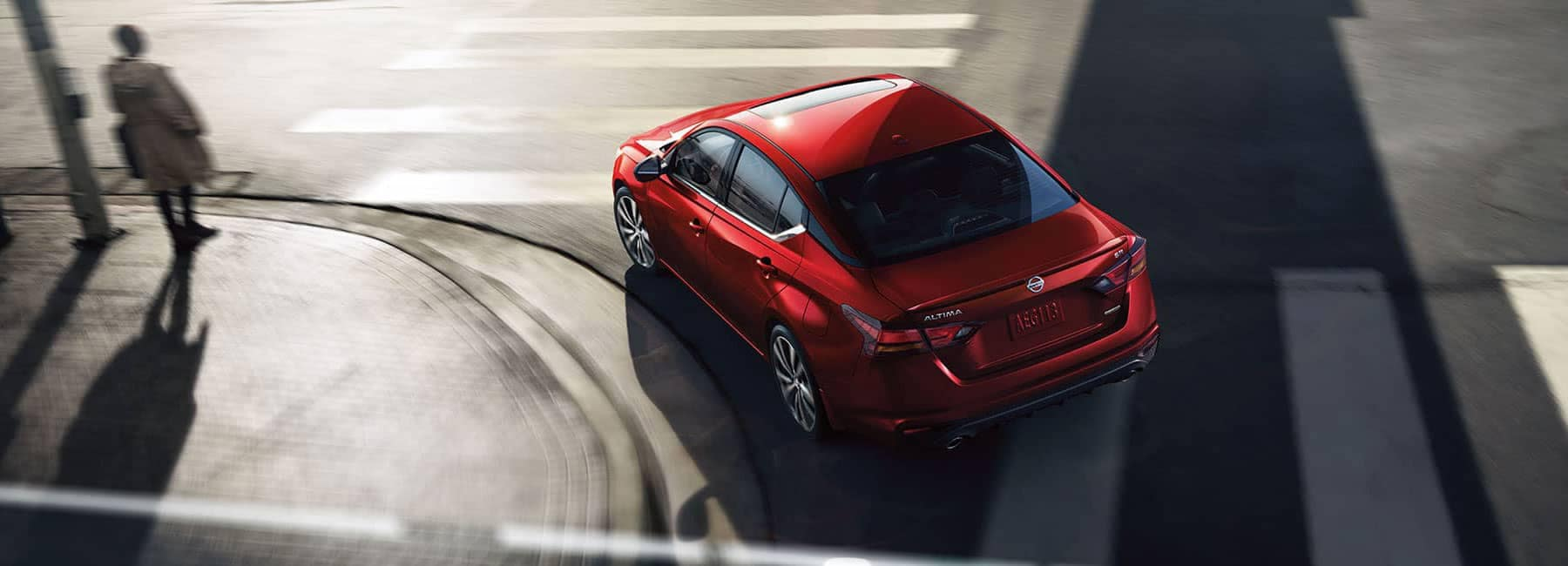 Documents to purchase a car at Boch Nissan in Norwood | Red Nissan altima on the road