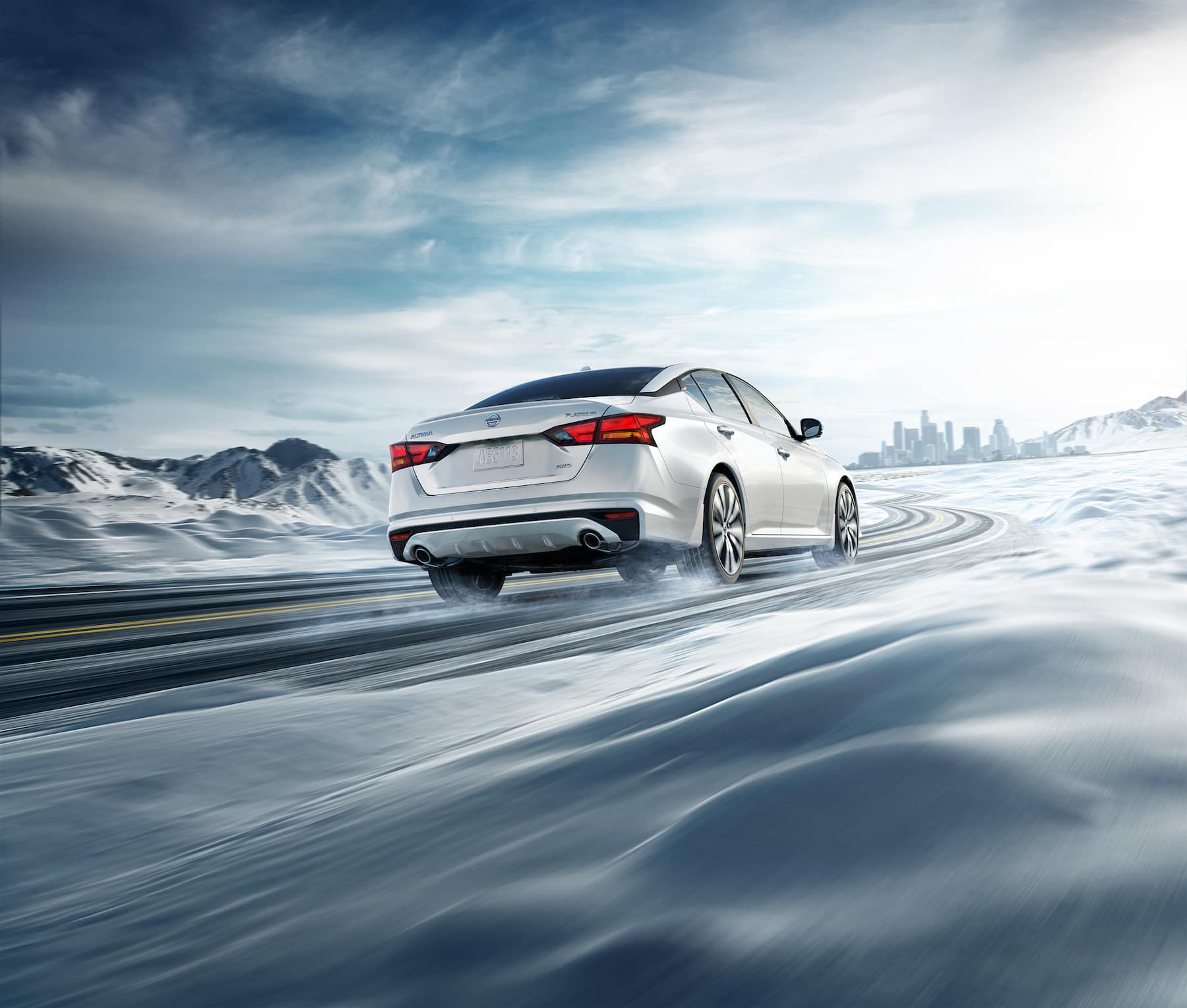 Model Features of the 2020 Nissan Altima at Boch Nissan of Norwood | white nissan altima driving in the snow