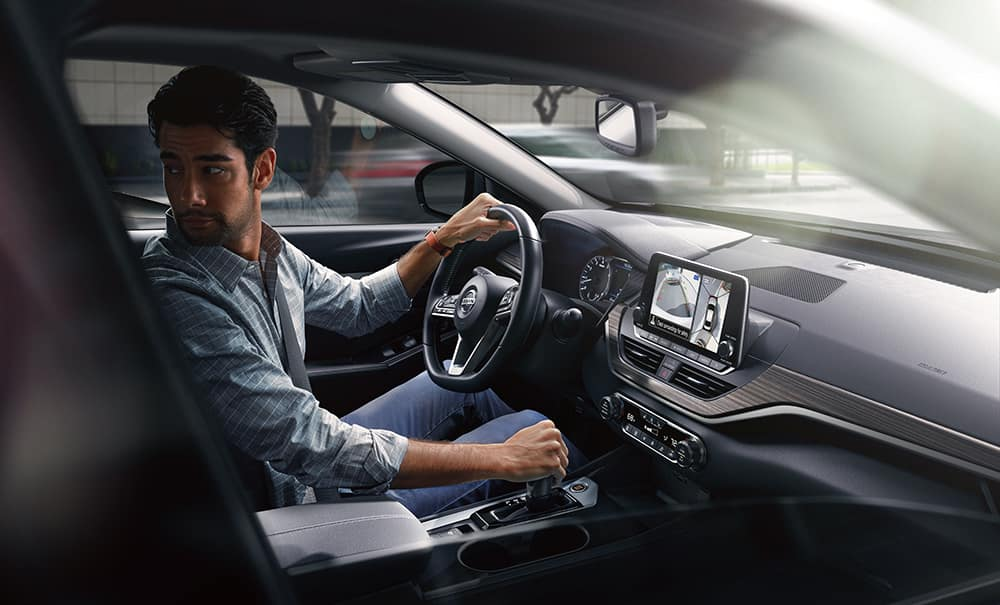 Model Features of the 2020 Nissan Altima at Boch Nissan of Norwood | man driving the nissan altima