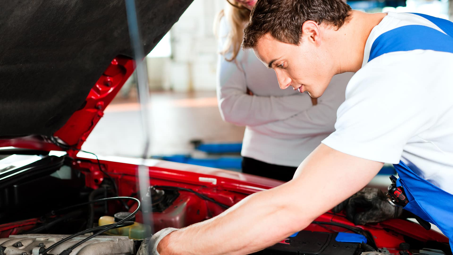 Oil Changes at Boch Nissan in Norwood MA | Mechanic Checking Engine