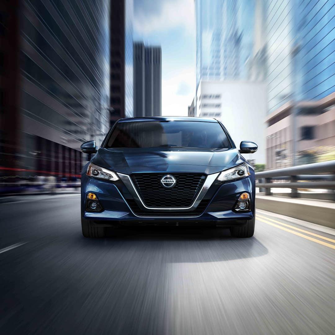 Boch Nissan is a Nissan Dealer Near Walpole MA | Blue 2020 Nissan Altima Driving Through City