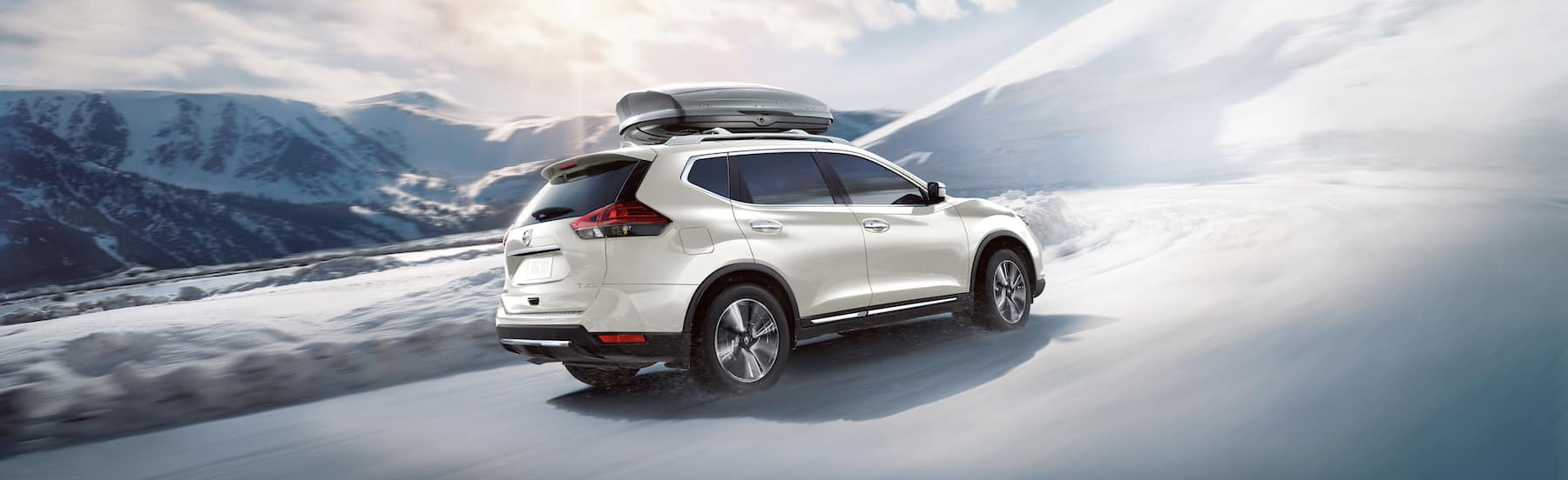 The 2020 Rogue model features at Boch Nissan South in North Attleboro | the 2020 rogue driving in the snow
