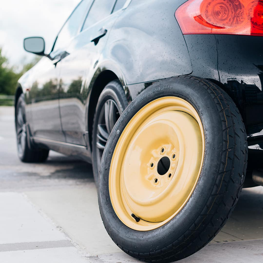 How to change a tire step-by-step guide at Boch Nissan South in Norwood | Spare Tire and Car
