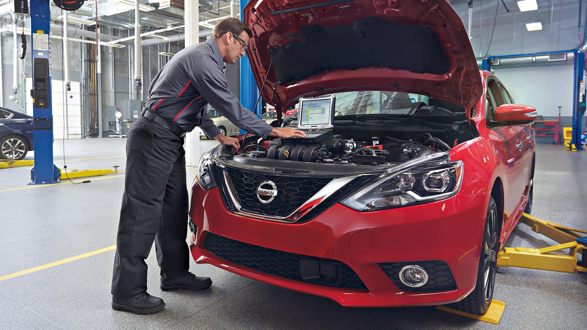 Boch Nissan South is a Family Owned Dealership near Attleboro, MA | Nissan mechanic running a diagnostics test