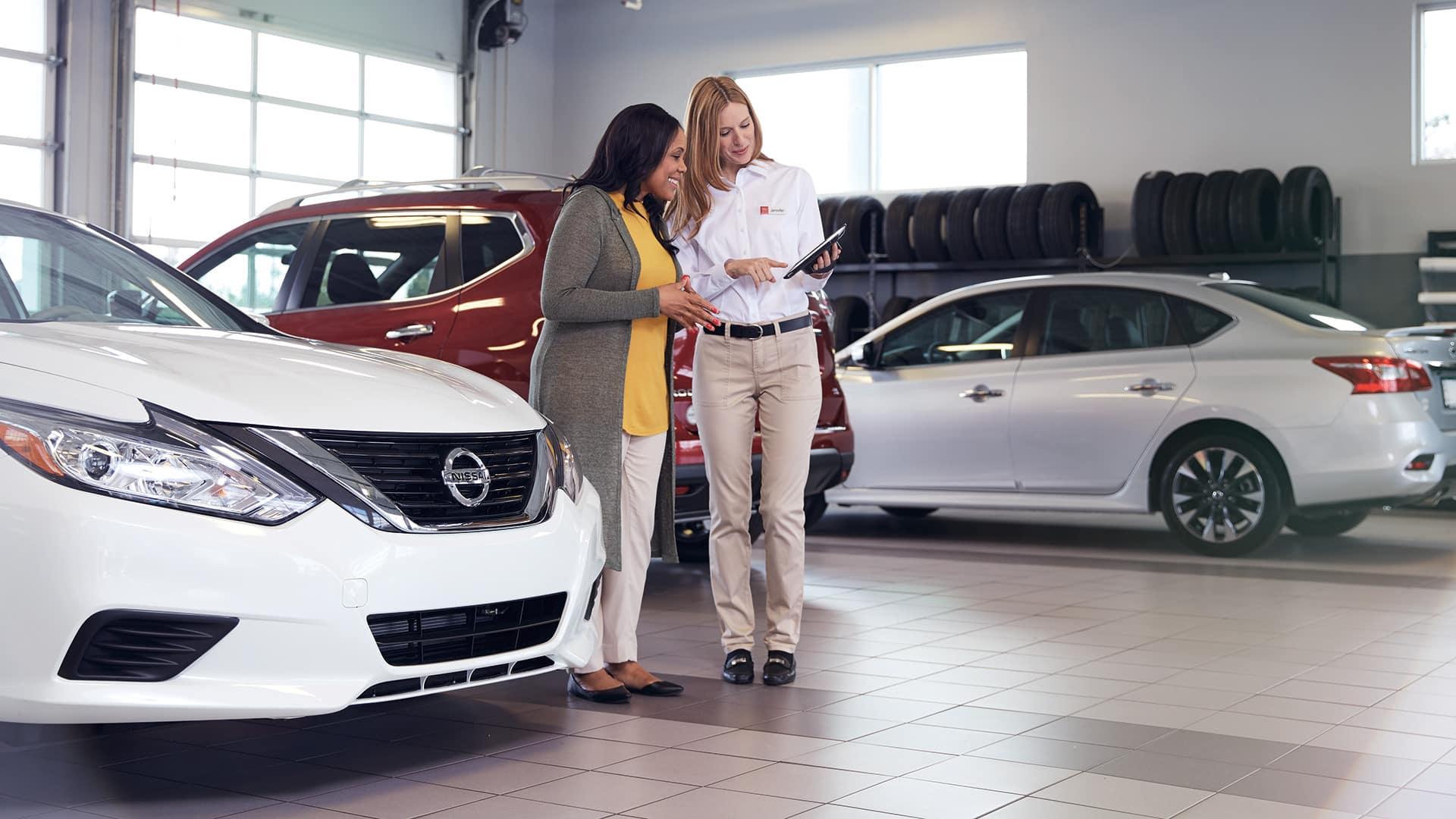Boch Nissan South is a Family Owned Dealership near Attleboro, MA | Nissan associate helping a customer