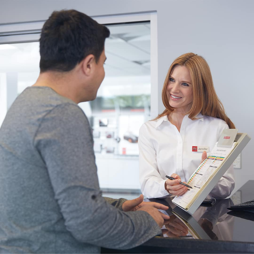 Boch Nissan South is a Nissan Dealer Near Plainville MA | Nissan Financial Advisor Discussing Finances with Customer