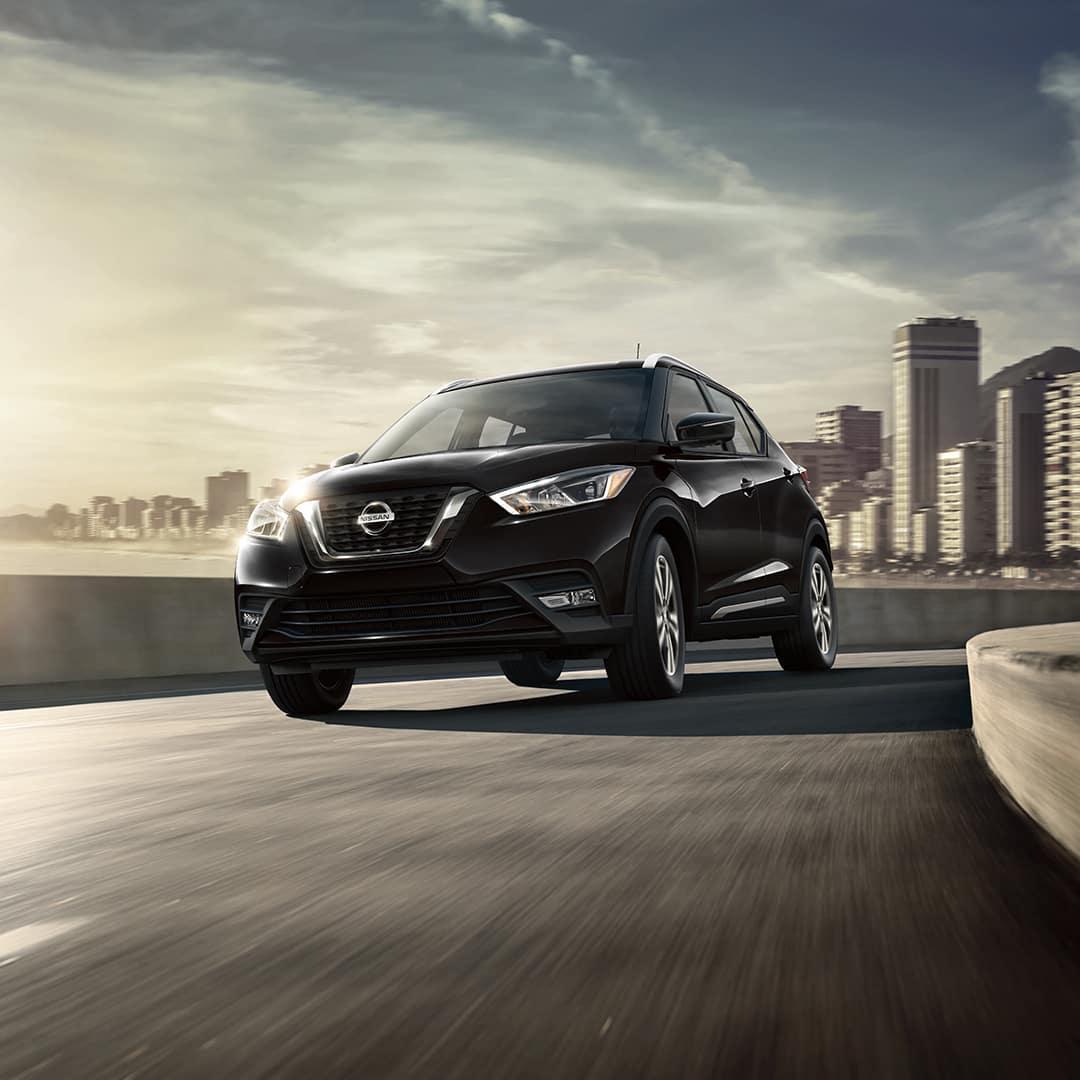 Boch Nissan South is a Nissan Dealer Near Plainville MA | Black 2020 Nissan Kicks Driving Away from City