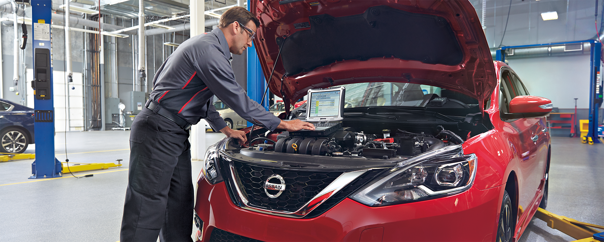Boch Nissan South is a Family Owned Dealership near Mansfield, MA | Nissan mechanic diagnosing the performance of a vehicle