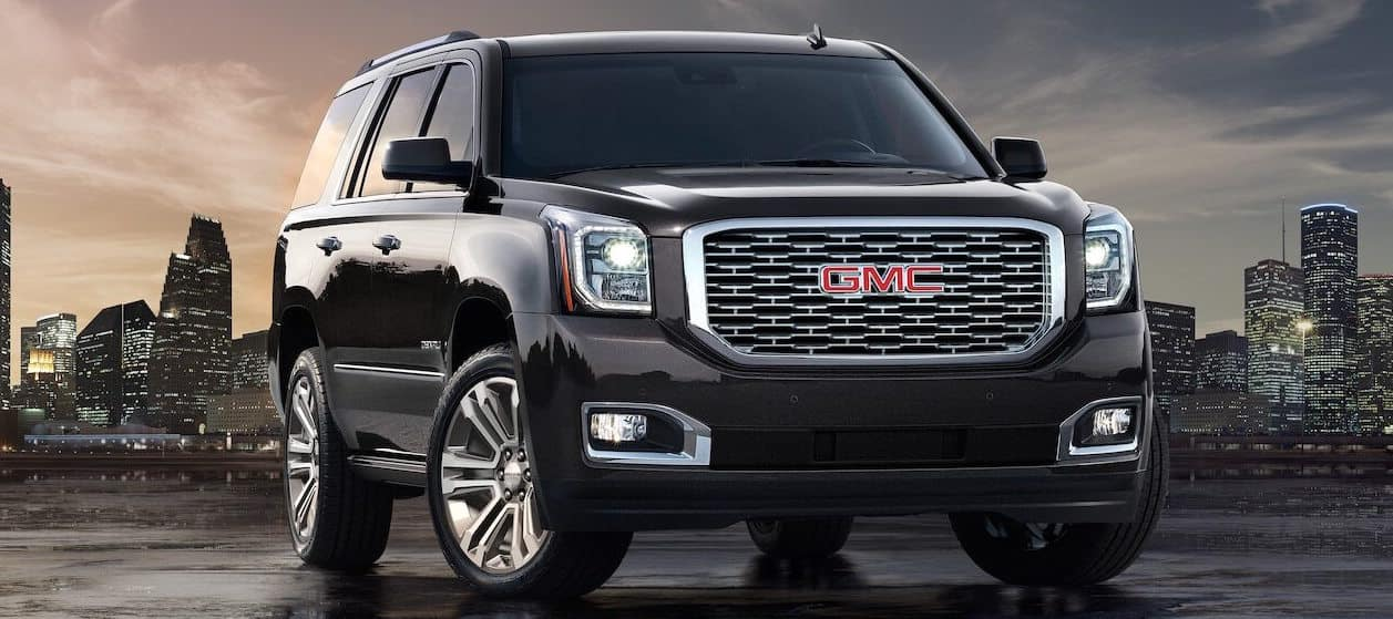 GMC Denali SUV parked in front of a skyline