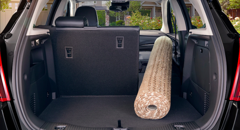 Buick Encore trunk with a large folded rug in it