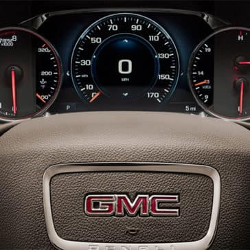 Close up of GMC Acadia steering wheel and controls