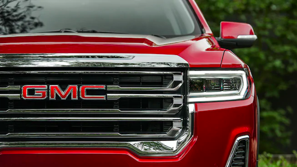 2020 gmc acadia red exterior front zoom up of grille