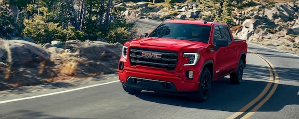 2020 red gmc sierra 1500 exterior driving on road