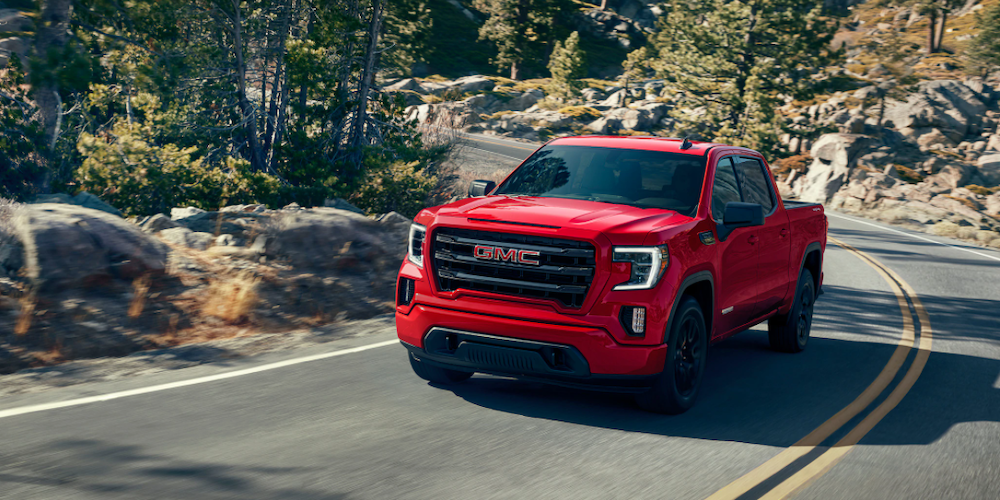 2020 gmc sierra sle red exterior driving down road