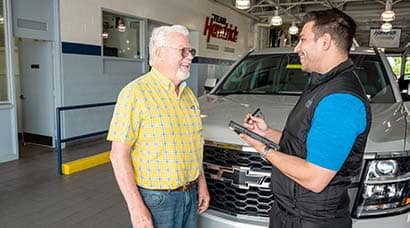 A Hendrick employee discussing trade in options