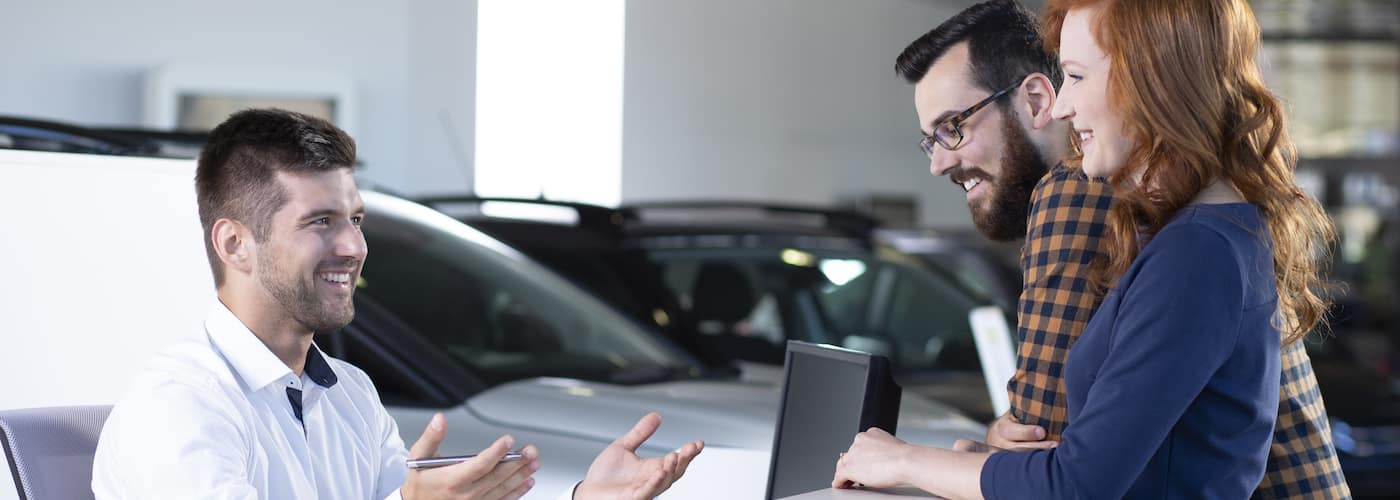 couple trading in a car