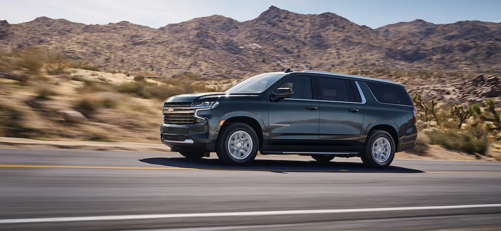 2021 chevy suburban black exterior driving down road