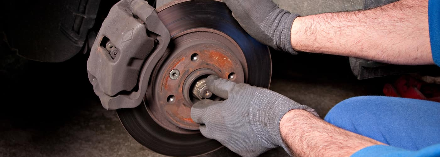 mechanic repairing brakes close up