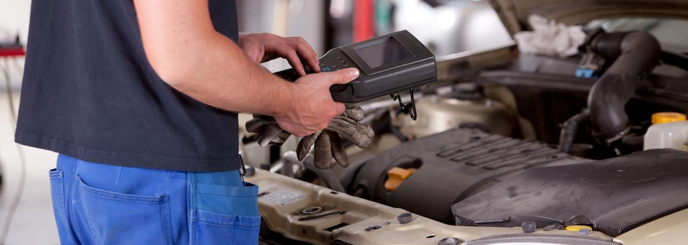 mechanic reviewing car specs