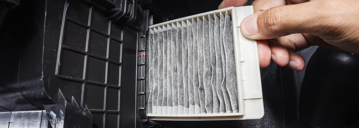 close up of cabin air filter being replaced