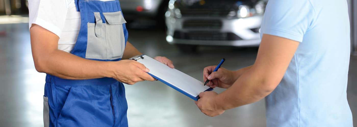 mechanic reviewing car service bill