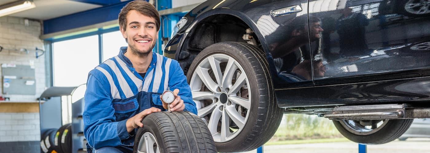 mechanic checking tire tread closeup